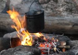 A pot boiling water over a fire, just like in the recipe.
